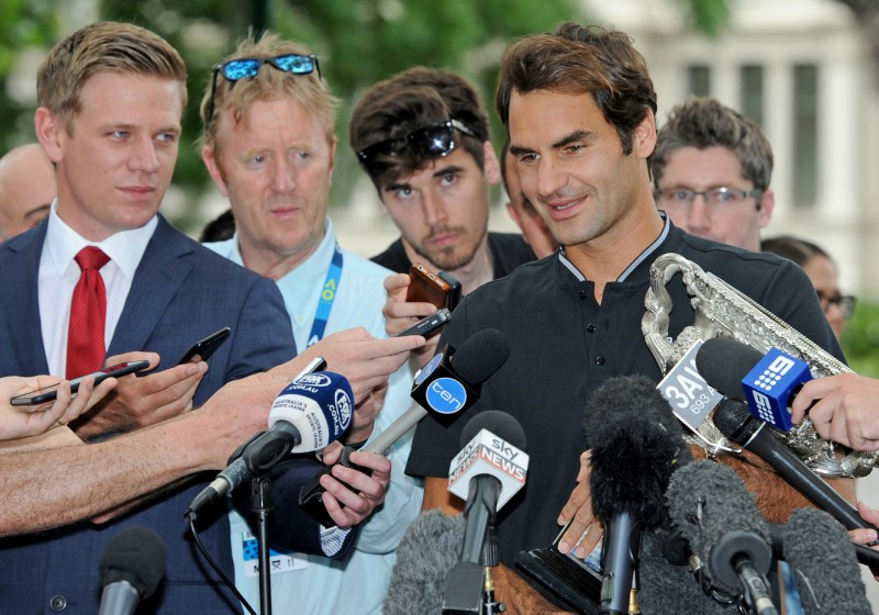 The champions mingles with the media
