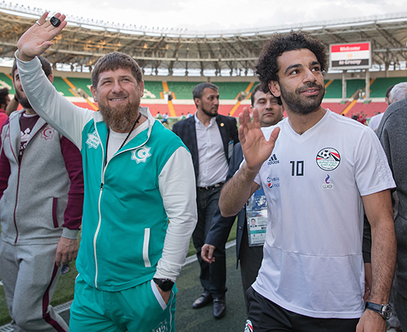 Chechen leader Ramzan Kadyrov (L) and Egyptian national soccer team striker Mohamed Salah (C) during a training of Egyptian national soccer team at the Akhmat Arena stadium in Grozny, Chechen Republic, Russia, 10 June 2018 (issued 13 June 2018). The Egyptian national soccer team prepares for the FIFA World Cup 2018 taking place in Russia from 14 June until 15 July 2018.  EPA/KAZBEK VAKHAYEV PICTURE MADE AVAILABLE TODAY