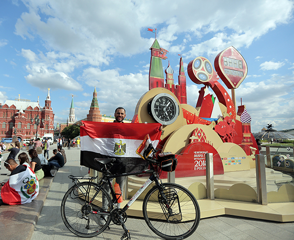 Egyptian traveller and cyclist Mohamed Nufal 'Ibn Nufal' poses with Egyptian flag in Red Square in Moscow, Russia, 13 June 2018. Ibn Nufal reached Russia after cycling about 5,000 km (3,000 miles) in 65 days from Egypt to Russia to support Egyptian team during the FIFA World Cup taking place in Russia from 14 June to 15 July 2018.  EPA/MAHMOUD KHALED