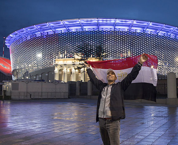An Egyptian soccer fan hold the national flag outside the Central Stadium in Ekaterinburg, Russia, 13 June 2018. The FIFA World Cup will take place in Russia from 14 June to 15 July 2018.  EPA/ROMAN PILIPEY
