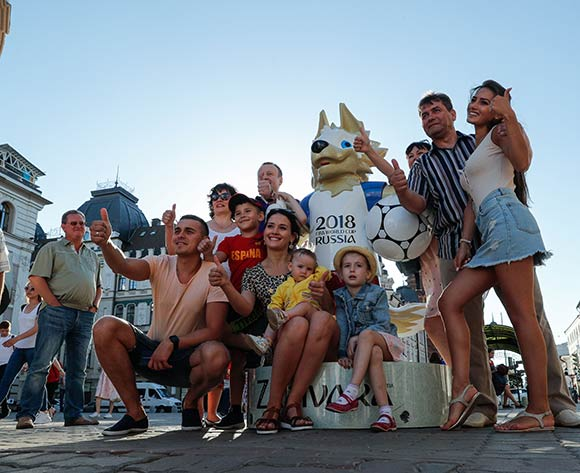 People pose for a picture with the FIFA World Cup official mascot Zabivaka in downtown Kazan, Russia, 18 June 2018. The FIFA World Cup takes place in Russia from 14 June until 15 July 2018.  EPA/Sergey Dolzhenko