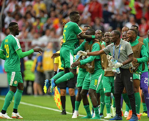 Idrissa Gueye (2-L) of Senegal and his teammates celebrate their 1-0 lead during the FIFA World Cup 2018 group H preliminary round soccer match between Poland and Senegal in Moscow, Russia, 19 June 2018. EPA/Peter Powell