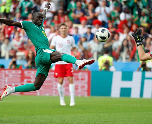 Sadio Mane (L) of Senegal and goalkeeper Wojciech Szczesny (R) of Poland in action during the FIFA World Cup 2018 group H preliminary round soccer match between Poland and Senegal in Moscow, Russia, 19 June 2018.EPA/Felipe Trueba