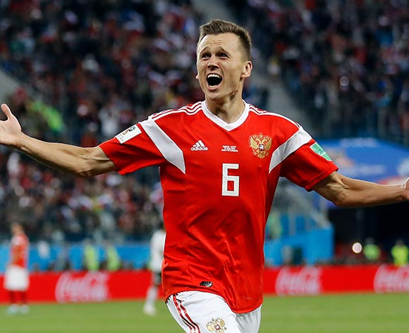 Denis Cheryshev of Russia celebrates scoring the 2-0 during the FIFA World Cup 2018 group A preliminary round soccer match between Russia and Egypt in St.Petersburg, Russia, 19 June 2018. EPA/Etienne Laurent