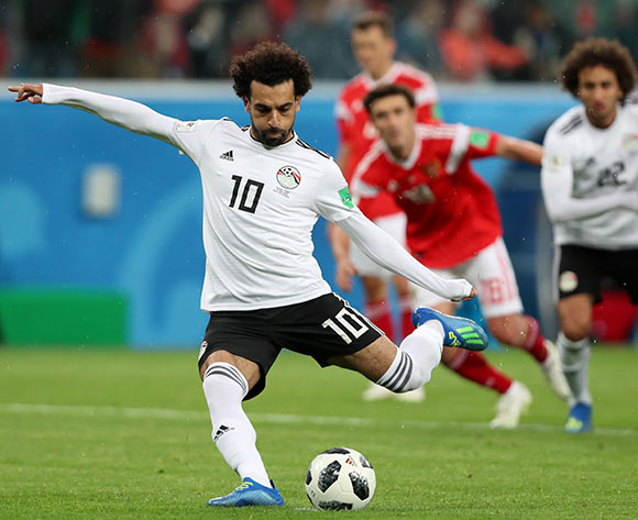 Mohamed Salah of Egypt scores from the penalty spot during the FIFA World Cup 2018 group A preliminary round soccer match between Russia and Egypt in St.Petersburg, Russia, 19 June 2018. EPA/Tolga Bozoglu