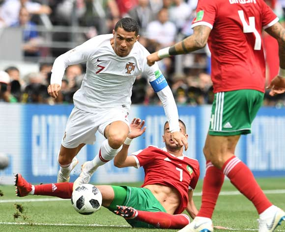 Cristiano Ronaldo (L) of Portugal and Hakim Ziyach (C) of Morocco in action during the FIFA World Cup 2018 Group B match between Portugal and Morocco in Moscow, Russia, 20 June 2018. EPA/Facundo Arrizabalaga
