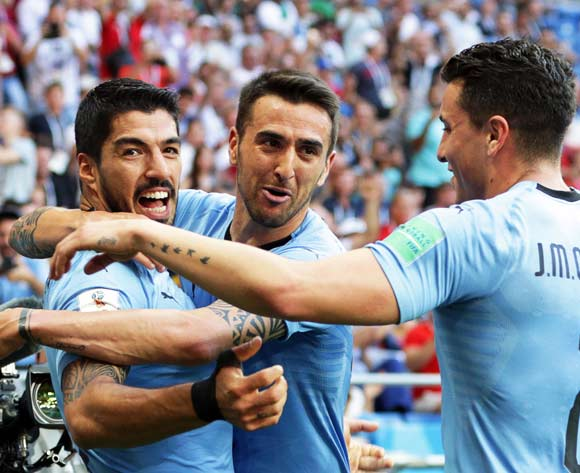 Luis Suarez (L) of Uruguay celebrates with his teammates after scoring the 1-0 lead during the FIFA World Cup 2018 group A preliminary round soccer match between Uruguay and Saudi Arabia in Rostov-On-Don, Russia, 20 June 2018.EPA/Khaled Elfiqi