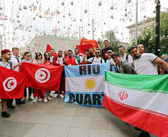 Supporters of (L-R) Tunisia, Argentina, and Iran gather in central Moscow, Russia, 21 June 2018. Tunisia will face Belgium in the FIFA World Cup 2018 group G preliminary round soccer match on 23 June 2018. EPA/Abedin Taherkenareh