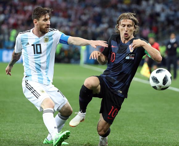 Lionel Messi of Argentina (L) and Luka Modric of Croatia in action during the FIFA World Cup 2018 group D preliminary round soccer match between Argentina and Croatia in Nizhny Novgorod, Russia, 21 June 2018.EPA/Vassil Donev