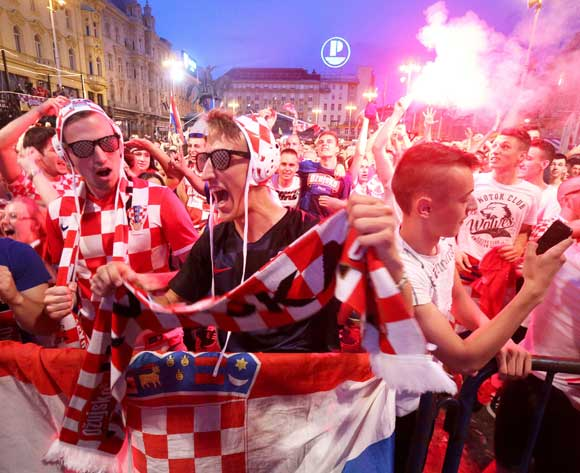 Supporters of Croatia celebrate as they watch the broadcast of the FIFAWorld Cup 2018 group D preliminary round soccer match between Argentina and Croatia in central Zagreb, Croatia, 21 June 2018. EPA/Daniel Kasap