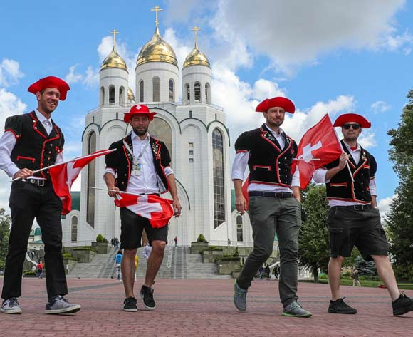 Suporters of Switzerland walk in front of a church in the centre of Kaliningrad, Russia, 22 June 2018. Serbia will face Switzerland in the FIFA World Cup 2018 Group E preliminary round soccer match on 22 June 2018.  EPA/Armando Babani