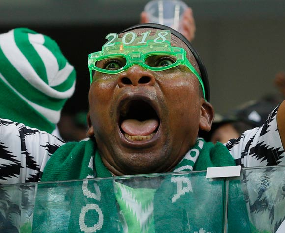 A supporter of Nigeria celebrates after the FIFA World Cup 2018 group D preliminary round soccer match between Nigeria and Iceland in Volgograd, Russia, 22 June 2018. Nigeria won the match 2-0. EPA/Zurab Kurtsikidze