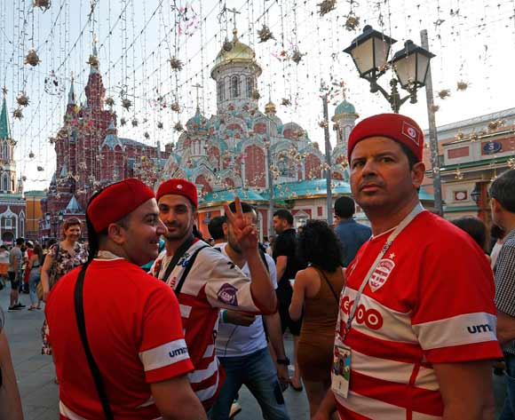 Fans of Tunisia walk in Nikolskaya street dubbed the 'Street of Light' near Kremlin, one of the favourite meeting points in the Russian capital for soccer fans during the FIFA World Cup 2018, Moscow, Russia, 22 June 2018. EPA/Sergei Chirikov