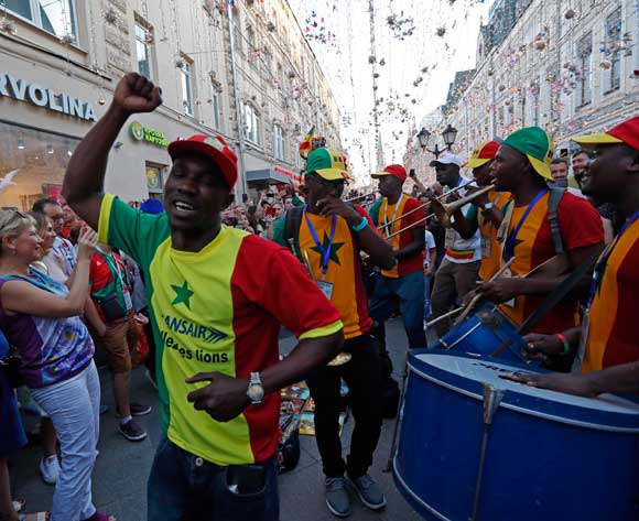 Fans of Senegal walk in Nikolskaya street dubbed the 'Street of Light' near Kremlin, one of the favourite meeting points in the Russian capital for soccer fans during the FIFA World Cup 2018, Moscow, Russia, 22 June 2018.  EPA/Sergei Chirikov