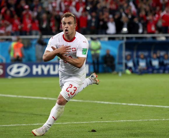 Xherdan Shaqiri of Switzerland celebrates scoring the 2-1 lead during the FIFA World Cup 2018 group E preliminary round soccer match between Serbia and Switzerland in Kaliningrad, Russia, 22 June 2018. EPA/Martin Divisek