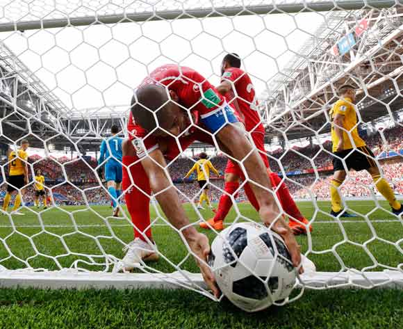 Wahbi Khazri of Tunisia picks the ball out of the net after scoring his team's second goal during the FIFA World Cup 2018 group G preliminary round soccer match between Belgium and Tunisia in Moscow, Russia, 23 June 2018. Belgium won 5-2. EPA/Felipe Trueba