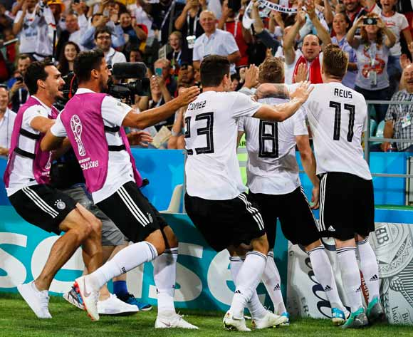 Toni Kroos (2-R) of Germany celebrates with his teammates after scoring the winning goal during the FIFA World Cup 2018 group F preliminary round soccer match between Germany and Sweden in Sochi, Russia, 23 June 2018. Germany won 2-1. EPA/Ronald Witt
