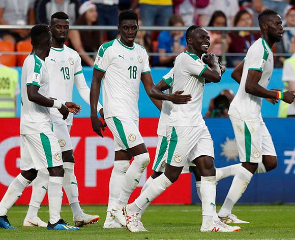 Players of Senegal celebrate the 2-1 lead during the FIFA World Cup 2018 group H preliminary round soccer match between Japan and Senegal in Ekaterinburg, Russia, 24 June 2018.EPA/Atef Safadi