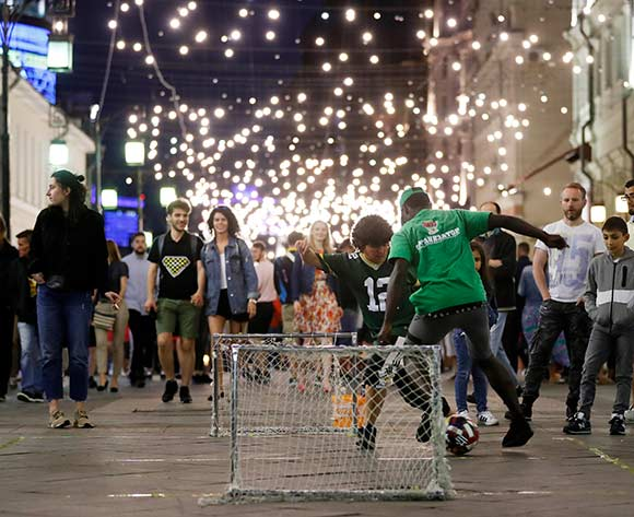 People play football in Nycholskaya Street, in Moscow, Russia, 24 June 2018. The FIFA World Cup 2018 takes place in Russia from 14 June until 15 July 2018.  EPA/Feli[e Trueba