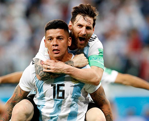 Marcos Rojo of Argentina celebrates with teammate Lionel Messi (top) after scoring the 2-1 during the FIFA World Cup 2018 group D preliminary round soccer match between Nigeria and Argentina in St.Petersburg, Russia, 26 June 2018. EPA/Anatoly Maltsev
