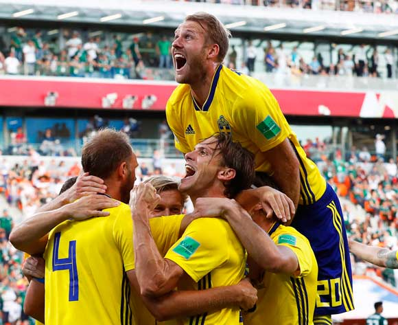 Sweden's Andreas Granqvist (L) celebrates with his teammates after scoring the 2-0 lead from the penalty spot during the FIFA World Cup 2018 group F preliminary round soccer match between Mexico and Sweden in Ekaterinburg, Russia, 27 June 2018.EPA/Atef Safadi