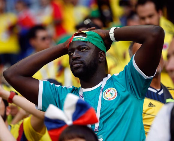 Senegal supporter reacts after the FIFA World Cup 2018 group H preliminary round soccer match between Senegal and Colombia in Samara, Russia, 28 June 2018. EPA/Wallace Woon