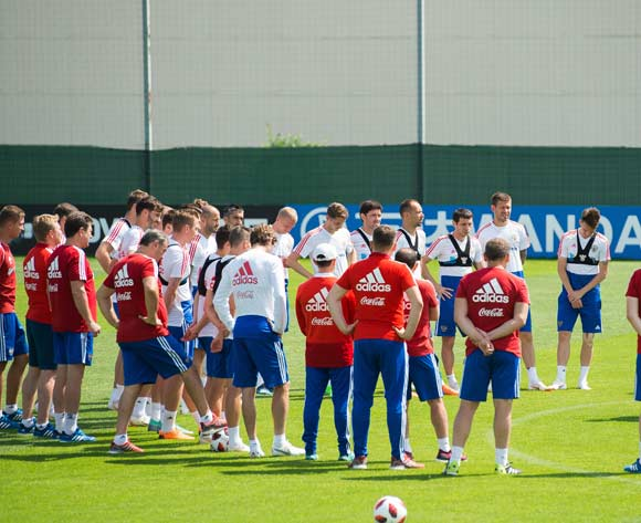 Russian head coach Stanislav Cherchesov  (R) talk to players during a training session held in Federal Sports Centre Novogorsk, Novogorsk, Russian Federation, 29 June 2018. Russia will face Spain the Round  of 16 of the FIFA World Cup 2018 on 01 July. EPA/Peter Powell