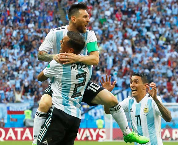 Gabriel Mercado (2) of Argentina celebrates with teammate Lionel Messi (top) after scoring the 2-1 lead during the FIFA World Cup 2018 round of 16 soccer match between France and Argentina in Kazan, Russia, 30 June 2018. EPA/Diego Azubel