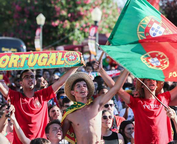 Portuguese fans cheers as they watch on a giant screen the FIFA World Cup 2018 round of 16 soccer match between Uruguay and Portugal, in Faro, Portugal, 30 June 2018. EPA/Luis Forra