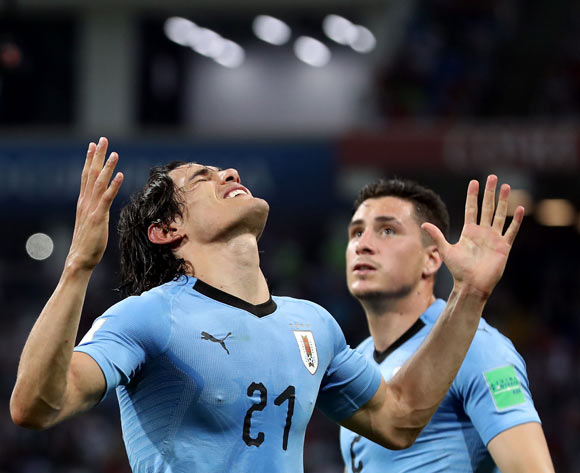 Edinson Cavani of Uruguay (L) celebrates scoring the 2-1 as Jose Gimenez of Uruguay looks on during the FIFA World Cup 2018 round of 16 soccer match between Uruguay and Portugal in Sochi, Russia, 30 June 2018. EPA/Friedmann Vogel