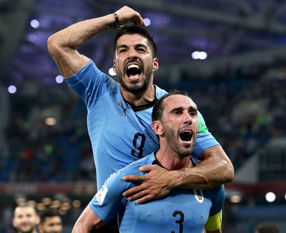 Luis Suarez of Uruguay (top) reacts with Diego Godin of Uruguay after the FIFA World Cup 2018 round of 16 soccer match between Uruguay and Portugal in Sochi, Russia, 30 June 2018. EPA/Friedmann Vogel