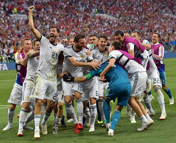 Players of Russia react after winning the FIFA World Cup 2018 round of 16 soccer match between Spain and Russia in Moscow, Russia, 01 July 2018. EPA/Peter Powell
