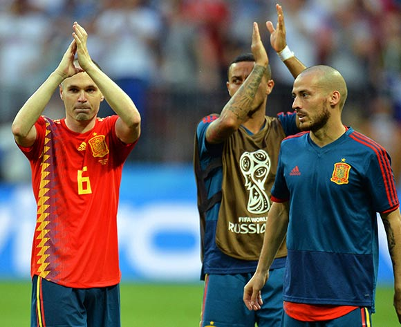 Andres Iniesta (L) of Spain and his teammates react after the penalty shootout of the FIFA World Cup 2018 round of 16 soccer match between Spain and Russia in Moscow, Russia, 01 July 2018. Russia won 4-3 on penalties. EPA/Peter Powell