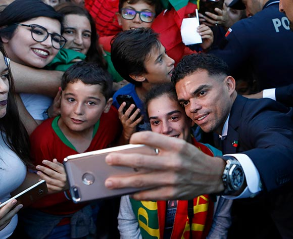 Portugal's Pepe takes a picture with fans at his arrival at Humberto Delgado airport in Lisbon, Portugal, 01 July 2018. After defeat against Uruguay, the Portugal national soccer team was eliminated from the FIFA World Cup 2018 round of 16. EPA/Antonio Pedro Santos