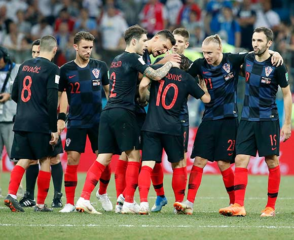 06856761Players of Croatia react after Luka Modric (C) scored the penalty shootout  after the FIFA World Cup 2018 round of 16 soccer match between Croatia and Denmark in Nizhny Novgorod, Russia, 01 July 2018. EPA/Frank Robichon