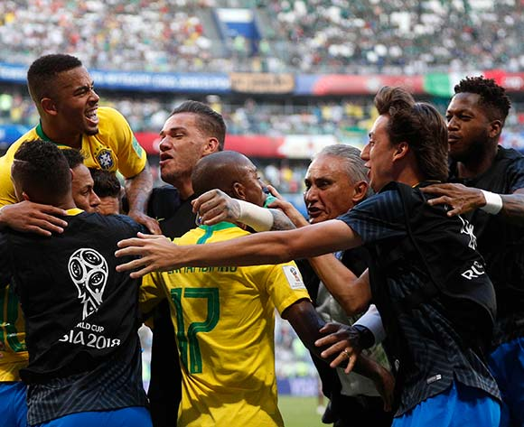 Roberto Firmino of Brazil (covered) celebrates with teammates scoring the 2-0 during the FIFA World Cup 2018 round of 16 soccer match between Brazil and Mexico in Samara, Russia, 02 July 2018. EPA/Sergey Dolzhenko