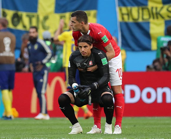 Goalkeeper Yann Sommer of Switzerland (front) and Granit Xhaka of Switzerland react after the FIFA World Cup 2018 round of 16 soccer match between Sweden and Switzerland in St.Petersburg, Russia, 03 July 2018. EPA/Georgi Licovski