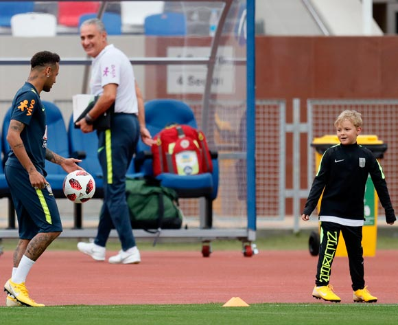 Brazil's player Neymar (L) his son Davi Lucca (R) and head coach Tite (C) during a training session in Sochi, Russia, 04 July 2018. Brazil will face Belgium in their FIFA World Cup 2018 quarter final soccer match on 06 July 2018 in Kazan.  EPA/Ronald Wittek
