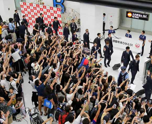 Japanese fans welcome members of Japan's soccer national team after the team returned to home following the FIFA World Cup Russia, at New Tokyo International Airport in Narita, Chiba Prefecture, Japan, 05 July 2018. EPA/Jiji Press