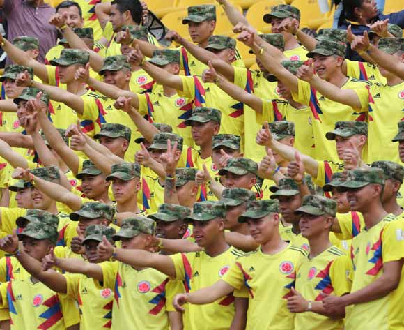 Members of the Colombian Army wave as they join other fans and await the arrival of Colombia's national soccer team on their return from the FIFA World Cup Russia 2018, during a welcoming ceremony at El Campin stadium, in Bogota, Colombia, 05 July 2018. EPA/Leonardo Munoz