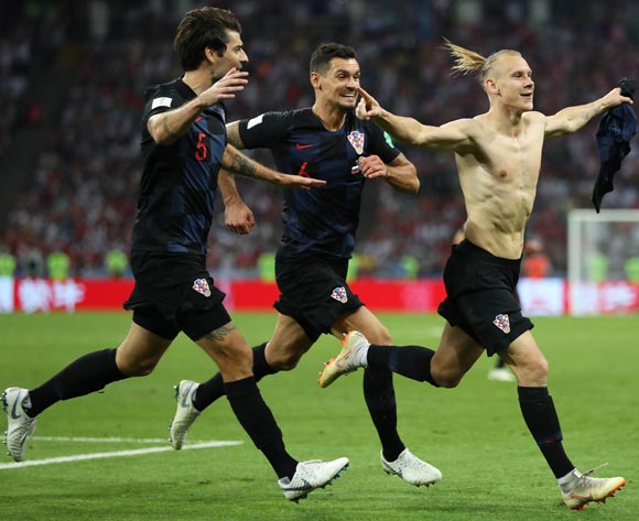 Domagoj Vida (R) of Croatia celebrates with his teammates after scoring the 2-1 lead during the FIFA World Cup 2018 quarter final soccer match between Russia and Croatia in Sochi, Russia, 07 July 2018. EPA/Friedemann Vogel