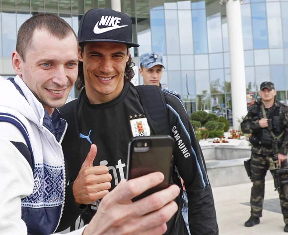 Uruguay's Edinson Cavani (2-L) poses for a selfie at the airport in Nizhny Novgorod, Russia, 08 July 2018. Uruguay dropped out of the FIFA World Cup 2018 after their 0-2 defeat against France in the quarter finals on 06 July. EPA/Juan Herrero