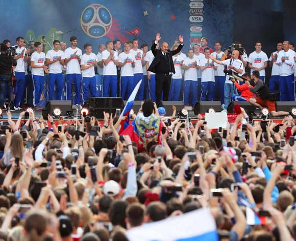 Players of the Russian national soccer team and their coach Stanislav Cherchesov (C) celebrate with fans at the FIFA Fan Festival zone in central Moscow, Russia 08 July 2018. Russia dropped out of the FIFA World Cup 2018 after their defeat against Croatia in the quarter finals on 07 July. EPA/Zurab Kurtsikidze