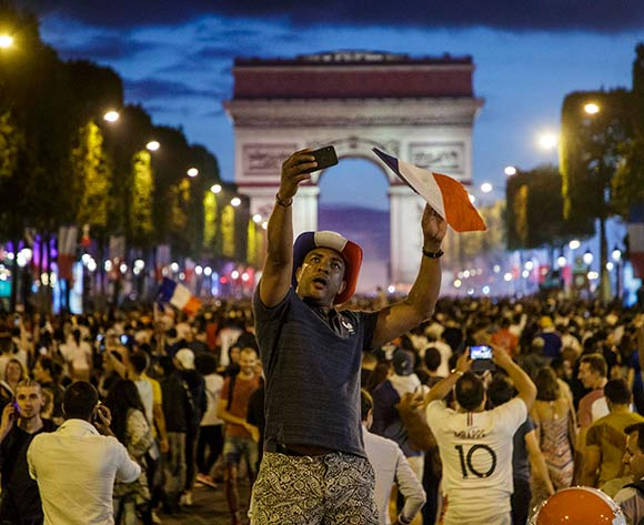 French supporters celebrate on the Champs Elysees their team's victory after the FIFA World Cup 2018 semi final match between France and Belgium in Paris, France, 10 July 2018. France won 1-0. EPA/Christophe Petit