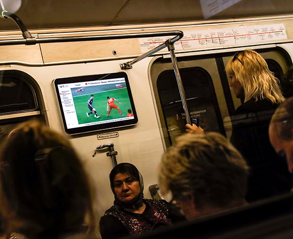 Passengers on the metro follow the FIFA World Cup 2018 semi final match between Belgium against France, in Moscow, Russia, 10 July 2018.  EPA/Felipe Trueba