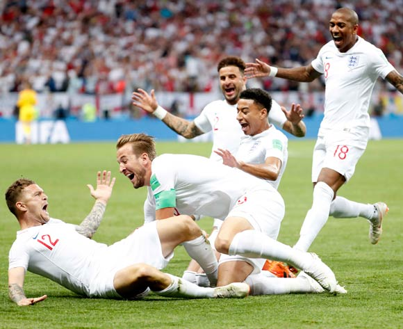 Kieran Trippier of England (left) celebrates with teammates after scoring the opening goal during the FIFA World Cup 2018 semi final soccer match between Croatia and England in Moscow, Russia, 11 July 2018.  EPA/Sergei Chirikov