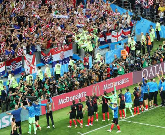 Players of Croatia celebrate with fans after the FIFA World Cup 2018 semi final soccer match between Croatia and England in Moscow, Russia, 11 July 2018. Croatia won 2-1 after extra time. EPA/Abedin Taherkenareh