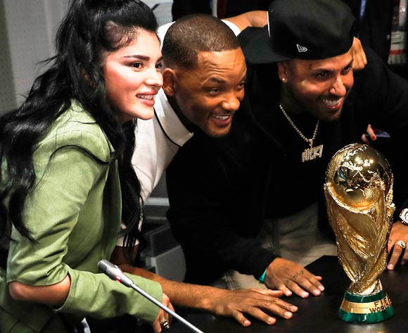 US singer Nicky Jam (R), US actor Will Smith and Kosovar singer Era Istrefi (L) pose with the World Cup troyphy during the FIFA World Cup 2018 closing ceremony press conference in Moscow, Russia, 13 July 2018. France will face Croatia in the FIFA World Cup 2018 final soccer match on 15 July. EPA/Felipe Trueba