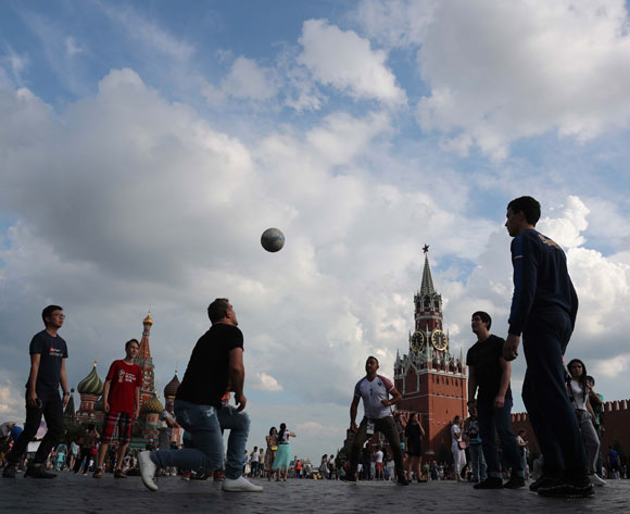 People play with a soccer ball on the Red Square in central Moscow, Russia, 13 July 2018. The FIFA World Cup 2018 takes place in Russia from 14 June until 15 July 2018. EPA/Zurab Kutrtsikidze