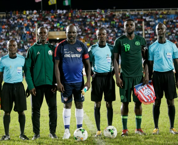 Liberia's President George Weah (3-L) poses with players a nd referees prior to the kock off aof an international friendly match between Liberia and Nigeria, to mark the official retirement Weah's official l #14 Jersey for Liberia, at the Samuel Kanyon Doe Sports Complex in Paynesville, Liberia, 11 Setember 2018